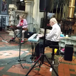 A rare shot of Zoot Money and Al Kirtley both concentrating on their playing. St. Peter's Church, Bournemouth 21 June 2019.