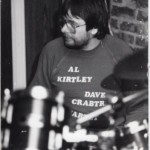 Mick Kirby at one of our early jazz gigs. Spot the then name of the band on his tee-shirt.